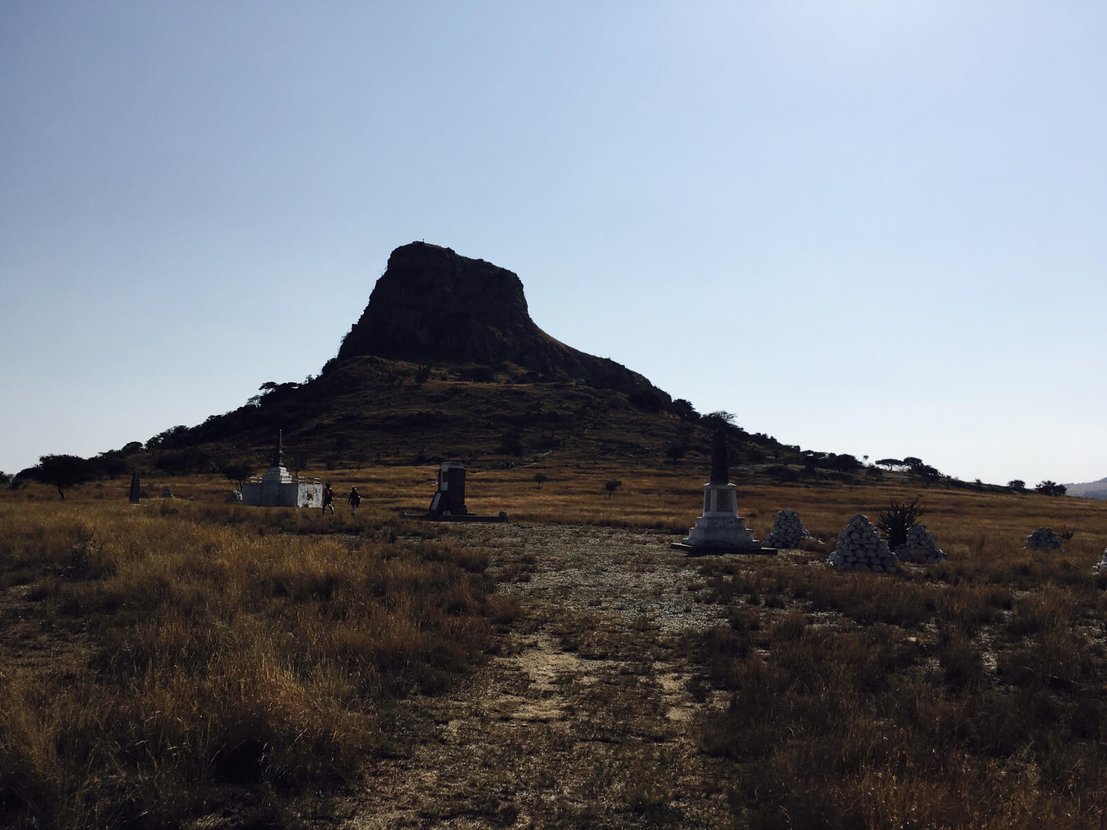 The cairns to the dead on the saddle of Isandhlwana hill. The Sphinx like shape of the mountain cast a sense of foreboding on the 24th Regiment of Foot as it resembled the insignia on their cap badges
